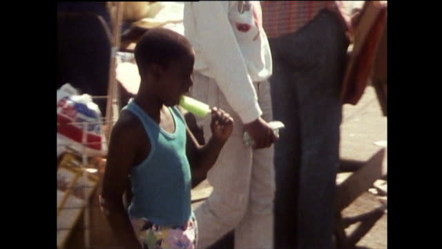 gvs of maxwell street market stalls and people in chicago; 1989 - flea market stock videos & royalty-free footage