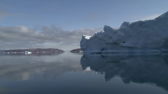 ilulissat gvs of icebergs/ice floes/lumps of ice in the sea / ice from melted glacier covering the surface of the sea - greenland stock videos & royalty-free footage