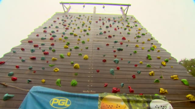 gvs of outdoor activity centre in surrey that is used for educational trips, empty and unused due to coronavirus pandemic - climbing equipment stock videos & royalty-free footage
