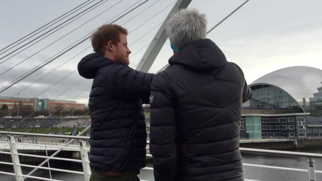 gvs of prince harry encouraging runners from charity headstogether as they run over newcastle's millenium bridge to train for the great north run - gateshead stock videos and b-roll footage