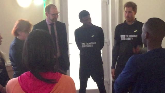 gvs of prince harry taking to the streets of london for a motivational run with a group of homeless youngsters who are being helped by a sports... - running shorts stock videos and b-roll footage
