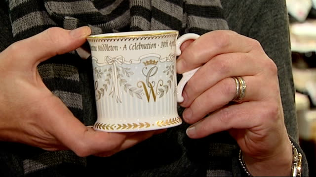 gvs of range of royal wedding china and interview close shot of china cup held and voiceover sot design inspired by wedding cake stripes at base are... - wedding ring stock videos & royalty-free footage