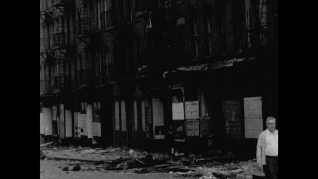GVs of run-down streets in New York's Bowery district; 1961