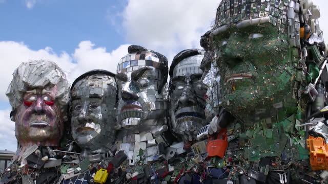 gvs of sculpture mount recyclemore, in st ives, cornwall, built from rubbish, and based on the g7 leaders, styled on mount rushmore, depicting the... - sculpture stock videos & royalty-free footage