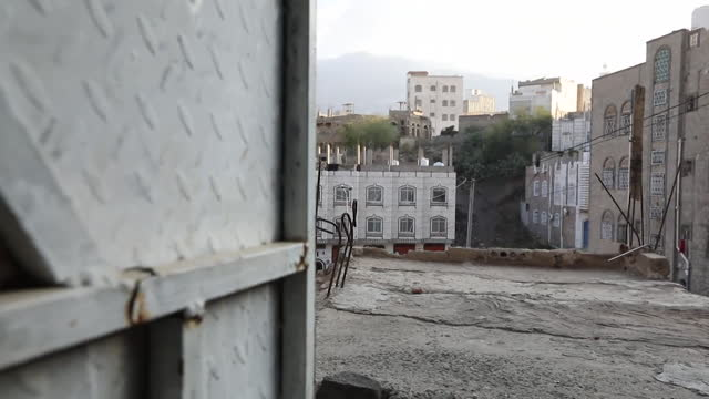gvs of street in taiz, yemen, where civil war between houthi rebels and government forces rages, sniper fire and air strikes can be heard - boundary stock videos & royalty-free footage