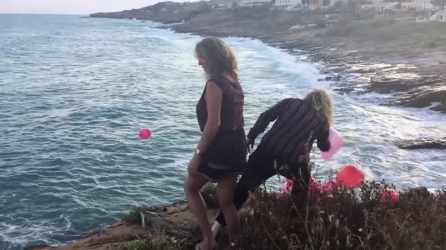 GVs of the balloons released in Praia Da Luz and of the candles and photos inside the church of Nossa Senhora da Luz to mark the 10th anniversary of...