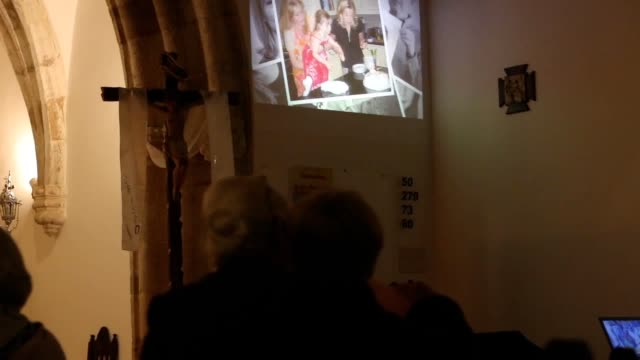 GVs of the church of Nossa Senhora da Luz after the service with images of the McCann family being shown on a wall and of the apartment and street...