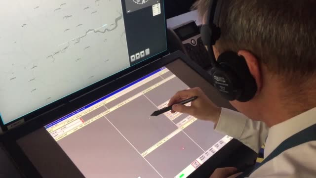 gvs of the operations room at the swanwick base of nats, from where controllers will direct aircraft at london city airport using the uk's first... - remote control video stock e b–roll