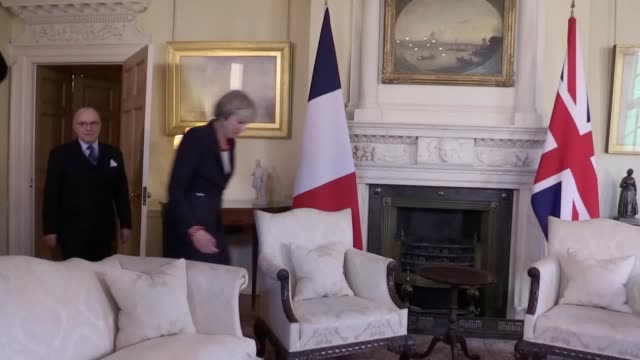 gvs of theresa may greeting french prime minister bernard cazeneuve at 10 downing street. gvs of the two exchanging warm words. - bernard cazeneuve stock videos & royalty-free footage