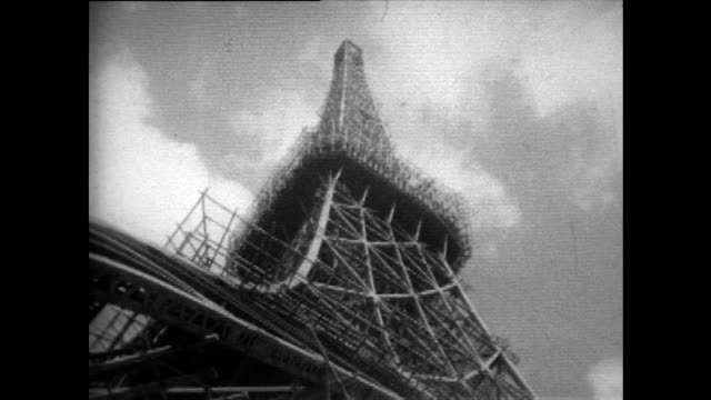 gvs of tokyo tower under construction in 1958 - grid stock videos & royalty-free footage