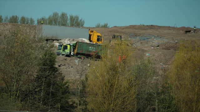 gvs of walleys quarrey landfill site in silverdale, newcastle-under-lyme, that is causing a smell due to increased levels of hydrogen sulphide - construction machinery stock videos & royalty-free footage