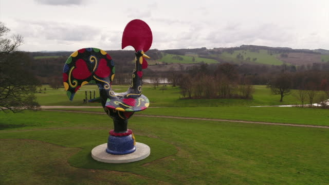 gvs of yorkshire sculpture park that we will benefit from a share of the government's culture recovery fund brought in due to coronavirus pandemic - making money stock videos & royalty-free footage