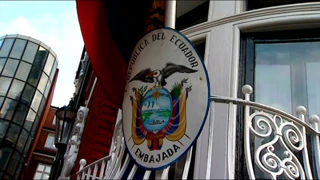 london knightsbridge ecuador embassy ext gvs of ecuadorean embassy / cu of emblem and flag / embassy entrance / men leaving embassy / gv of media... - number 3 stock videos & royalty-free footage