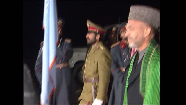 gvs tony blair visits bagram airbase; afghanistan: bagram: bagram airbase: int / night lms side & bms tony blair mp along meeting line up of british... - bagram stock videos & royalty-free footage