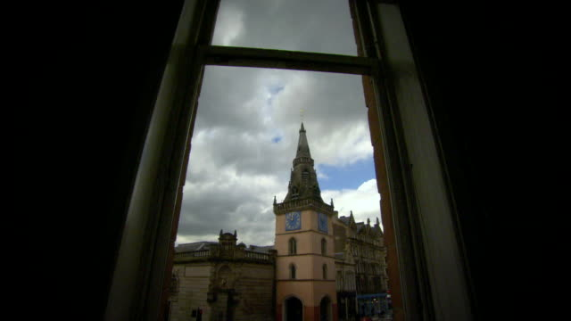 gvs tron theatre clock tower and tolbooth steeple, glasgow - clock tower stock videos & royalty-free footage