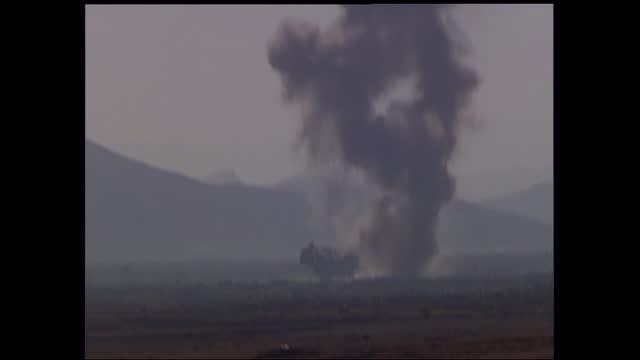 gvs us airstrikes on bagram air base; afghanistan: bagram: bagram airfield: ext / dusk gv large black cloud of smoke from explosion caused by... - bagram stock videos & royalty-free footage