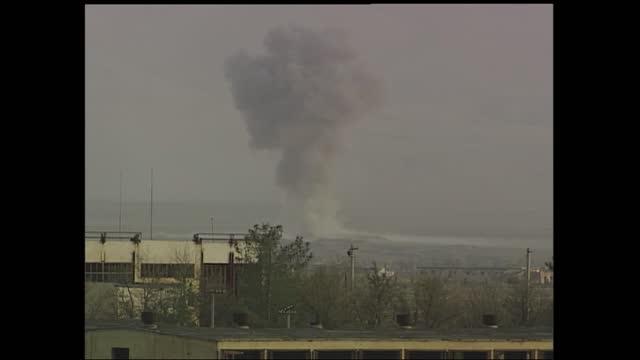 gvs us bombing bagram airbase; afghanistan: bagram: bagram airbase: ext 00:07:06 black smoke rising from distant bagram airbase from bomb gv... - bagram stock videos & royalty-free footage