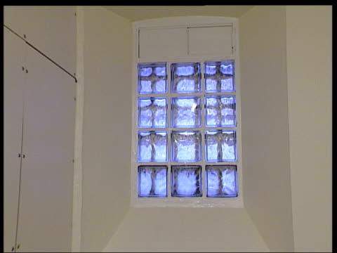 stockvideo's en b-roll-footage met gvs wandsworth prison interiors / exteriors itn london wandsworth prison security office tilt up to balconies pan round track into cell cms open door... - wandsworth