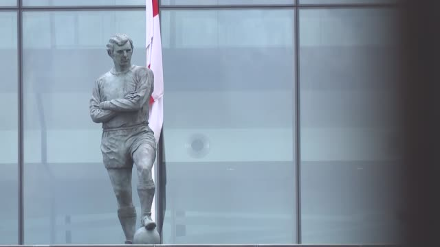 gvs wembley stadium gvs; england: london: wembley: ext gvs wembley stadium exterior with construction work outside including bobby moore statue,... - wembley stock videos & royalty-free footage