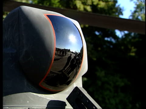 gvs westland apache military helicopters on tarmac reflective dome on apache exterior airman reflected in apache window pilot checking over... - アパッチヘリコプター点の映像素材/bロール
