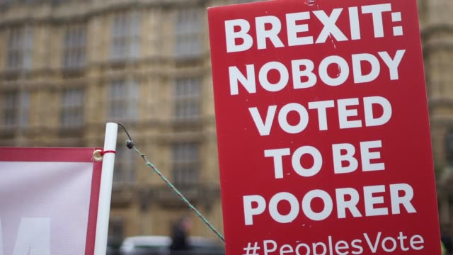 GVs Westminster including statue Brexit campaigners tourists ENGLAND London Westminster EXT Brexit placard 'Brexit Nobody voted to be poorer' / open...