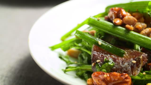'gwamegi' (half-dried billfish) seasoned with nuts - nut food stock videos & royalty-free footage