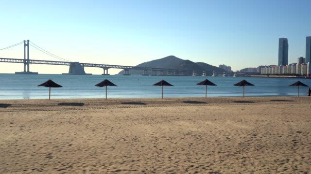 gwangalli beach during time sunrise at south korea - busan stock videos & royalty-free footage