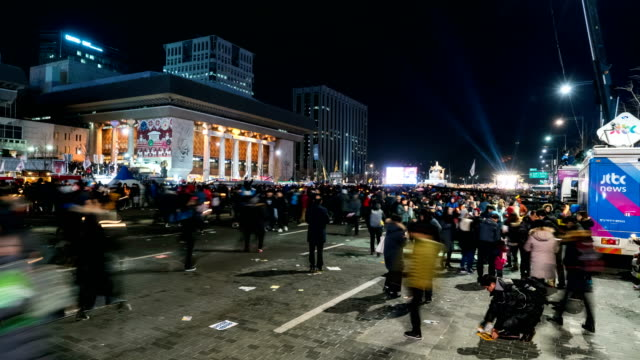 gwanghwamun square peaceful candlelight protest against president park geun hye to resign (one of the largest anti-government protests in korea) - protestor stock videos and b-roll footage