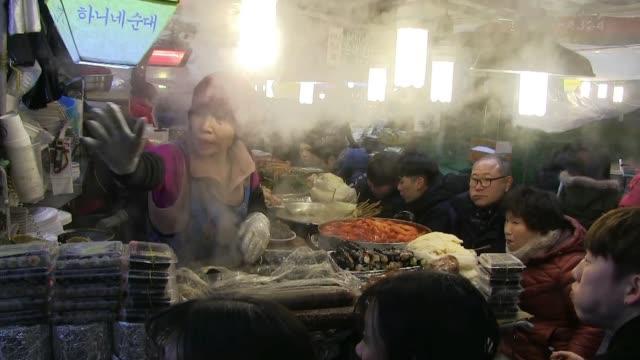 gwangjang market in seoul - tradition stock videos & royalty-free footage