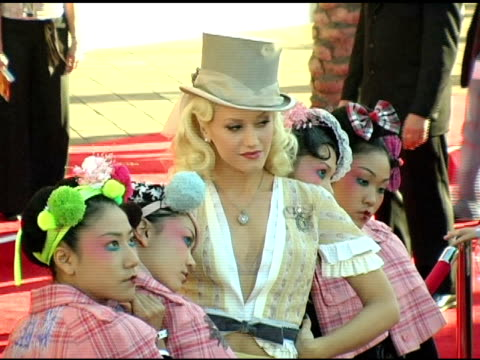 gwen stefani and harajuku girls at the 2004 american music awards red carpet at the shrine auditorium in los angeles, california on november 14, 2004. - gwen stefani stock videos & royalty-free footage