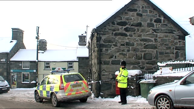 Gwynedd Trawsfynydd EXT Police car and police officer outside house where Melanie Stephens is thought to have killed two of her children before...