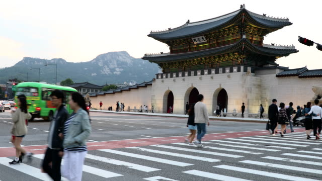 Gyeongbokgung palace large Gate and traffic in front of it , Seoul, South Korea