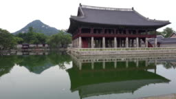Gyeonghoeru Pavilion and pond view at Gyeongbokgung palace in Seoul and mount Inwangsan in background in Seoul South Korea