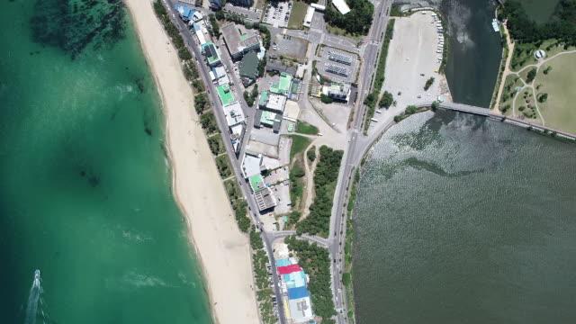 gyeongpo beach and gyeongpoho lake / gangneung-si, gangwon-do, south korea - standing water stock videos & royalty-free footage