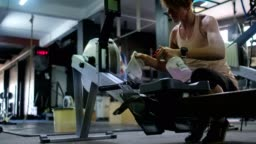 Gym owner sanitizing exercise equipment in the gym
