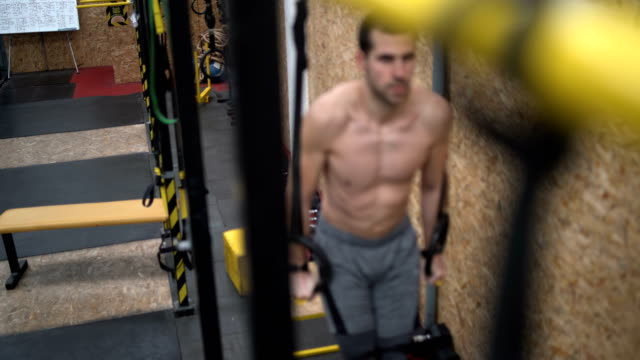 cross fit training on gymnastic rings - gymnastic rings stock videos & royalty-free footage