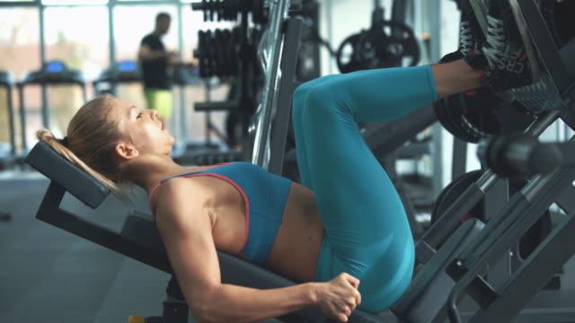 gym workout. - leg press stock videos & royalty-free footage