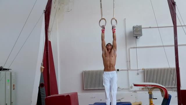 Gymnast athlete on rings
