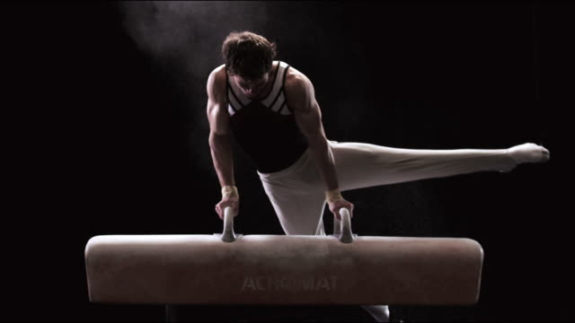 SLO MO Gymnast mounts and performs on pommel horse then dismounts / Auckland, New Zealand
