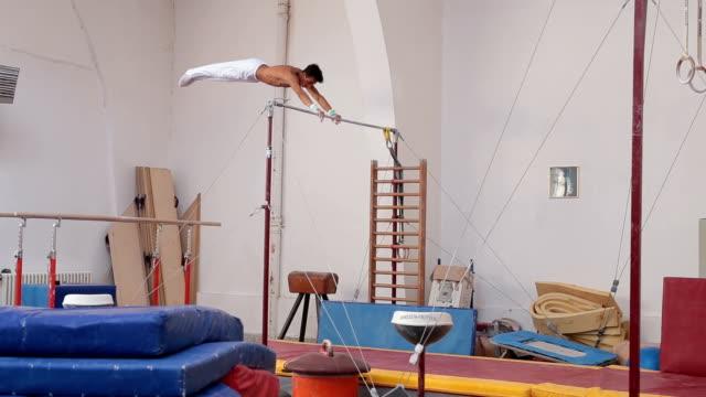 Gymnast on a gymnastics bar