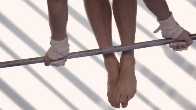 cu gymnast performing on horizontal bar / vancouver, british columbia, canada - horizontal bar stock videos & royalty-free footage