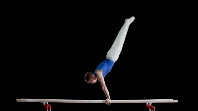 ld gymnast performing on parallel bars - gymnastics stock videos & royalty-free footage