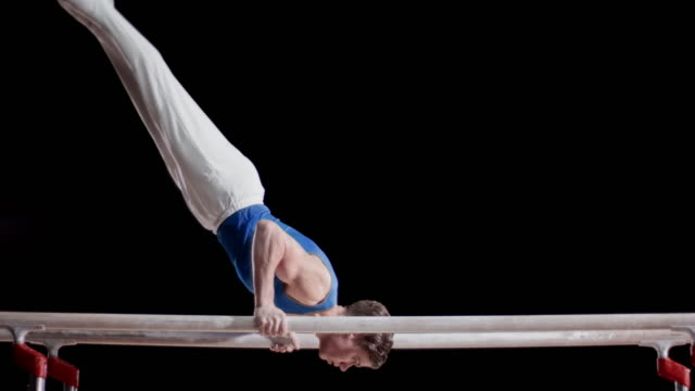 SLO MO Gymnast performing on parallel bars