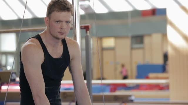 tu gymnast sitting in gymnasium / vancouver, british columbia, canada - staring stock videos & royalty-free footage