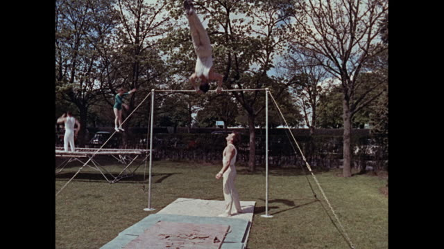 stockvideo's en b-roll-footage met montage gymnastic training in the army in england / united kingdom - de brug
