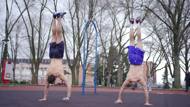 gymnastics athletes practicing their balance - upside down stock videos & royalty-free footage