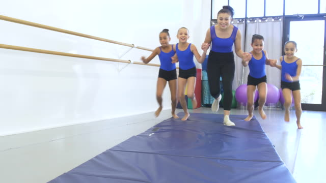 gymnastics coach with four girls in gym - 8 9 years stock videos & royalty-free footage