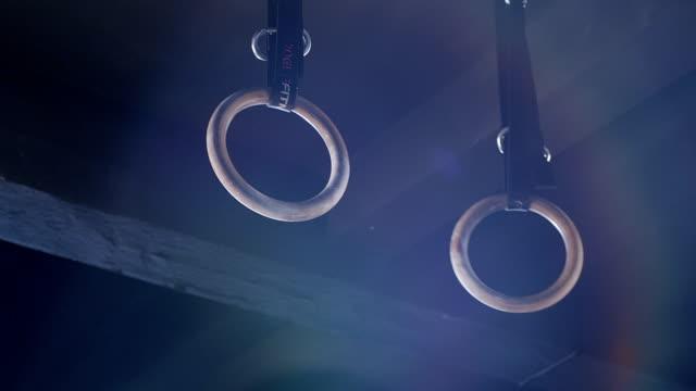 gymnastics rings. gym - gymnastic rings stock videos & royalty-free footage