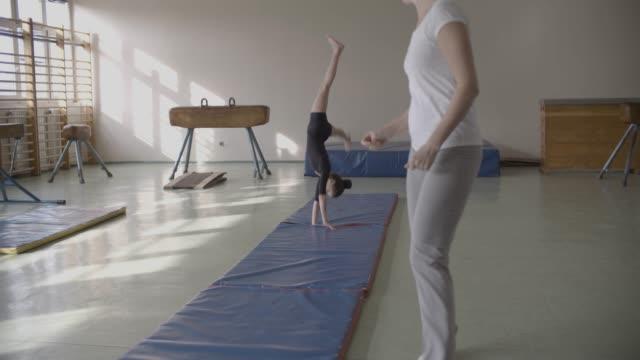 gymnastics training - cartwheel stock videos & royalty-free footage