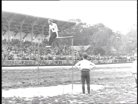 1918 montage gymnasts performing on the high bar / france - 1918 stock videos and b-roll footage